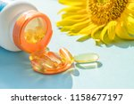 golden sunscreen pills with... | Shutterstock . vector #1158677197