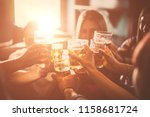 Stock photo group of teens having fun in a pub 1158681724