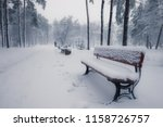 benches in winter snowy park at ... | Shutterstock . vector #1158726757
