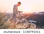 morning walk with dog. young... | Shutterstock . vector #1158791011