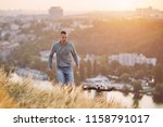 morning walk with dog. young... | Shutterstock . vector #1158791017