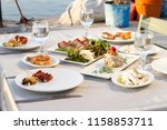 dishes with various seafood at... | Shutterstock . vector #1158853711