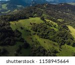 green forest and hills in... | Shutterstock . vector #1158945664