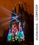 """Small photo of BARCELONA SPAIN - SEPTEMBER 26: """"La Sagrada Familia"""", the cathedral designed by Gaudi, with the spectacle """"ODA A LA VIDA"""" during Barcelona Mercè festival, on September 26, 2012 in Barcelona Spain."""