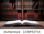 close up of an open law book on ... | Shutterstock . vector #1158952714