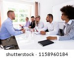 young man sitting at interview... | Shutterstock . vector #1158960184