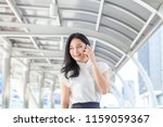 business woman using smartphone ... | Shutterstock . vector #1159059367