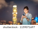 woman using smartphone in front ... | Shutterstock . vector #1159071697
