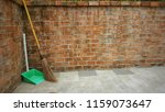 broom and dustpan next to a... | Shutterstock . vector #1159073647