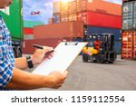 worker checking document in... | Shutterstock . vector #1159112554