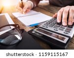 woman works on a calculator | Shutterstock . vector #1159115167