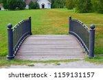 pedestrian bridge in the park.... | Shutterstock . vector #1159131157
