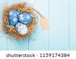 colorful easter eggs on desk | Shutterstock . vector #1159174384