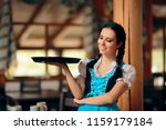 waitress wearing bavarian... | Shutterstock . vector #1159179184