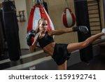 blond female fighter doing high ... | Shutterstock . vector #1159192741