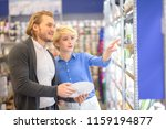 young married shopper people... | Shutterstock . vector #1159194877