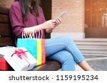 asian girls holding sale... | Shutterstock . vector #1159195234