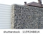 newly build gabions fence | Shutterstock . vector #1159248814