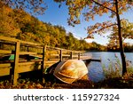 Row Boat Against Wood Dock In...