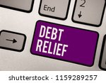 Conceptual hand writing showing Debt Relief. Business photo showcasing partial or total remission of it especially those by countries Keyboard purple key computer computing reflection document.