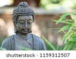 Buddah Sculpture In A Zen Garden