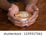 hand holding a hot latte coffee ... | Shutterstock . vector #1159317361