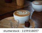 a cup of hot latte coffee cup | Shutterstock . vector #1159318057
