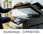bussiness man hand press button ... | Shutterstock . vector #1159367101
