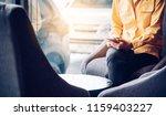 people play smartphone in... | Shutterstock . vector #1159403227