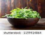 fresh rukkola on a wooden... | Shutterstock . vector #1159414864