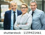 group of smiling mature... | Shutterstock . vector #1159421461