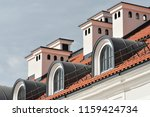 red tile roof with a windows.... | Shutterstock . vector #1159424734