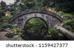 ancient stone bridge at the... | Shutterstock . vector #1159427377