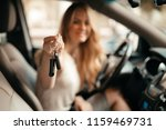 woman smiling showing new car... | Shutterstock . vector #1159469731