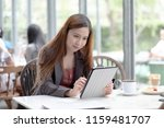 business woman sitting with a... | Shutterstock . vector #1159481707
