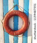 A Lifebuoy On White And Blue...