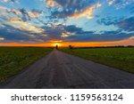 asphalt road among a green... | Shutterstock . vector #1159563124