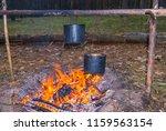 touristic camp scene  cauldron... | Shutterstock . vector #1159563154