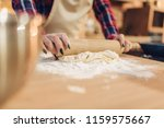 housewife rolls out the dough...   Shutterstock . vector #1159575667