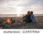 young couple relaxing by the... | Shutterstock . vector #1159575964