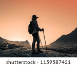 hiking in mountains | Shutterstock . vector #1159587421