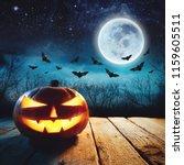 a glowing jack o lantern in a...   Shutterstock . vector #1159605511