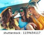 three female friends enjoying... | Shutterstock . vector #1159654117