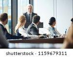 senior confident speaker... | Shutterstock . vector #1159679311