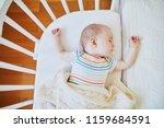 adorable baby girl sleeping in... | Shutterstock . vector #1159684591