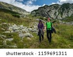 young couple in holiday hiking... | Shutterstock . vector #1159691311