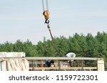 unloading with a crane. truck... | Shutterstock . vector #1159722301