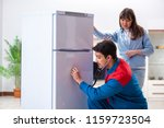 man repairing fridge with... | Shutterstock . vector #1159723504