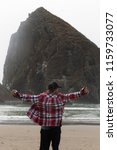 exploring cannon beach on the... | Shutterstock . vector #1159733077