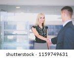 business people shaking hands...   Shutterstock . vector #1159749631